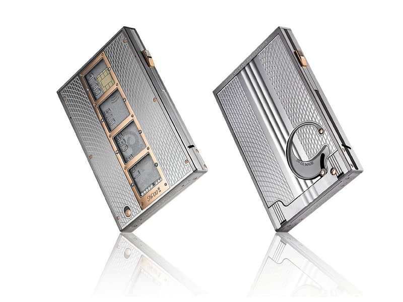 """The RCD82 """"Player"""" mechanical credit card dispenser in natural titanium with red gold trim and 4 sapphire windows"""